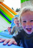 joyful children who jumps on a big inflatable trampoline